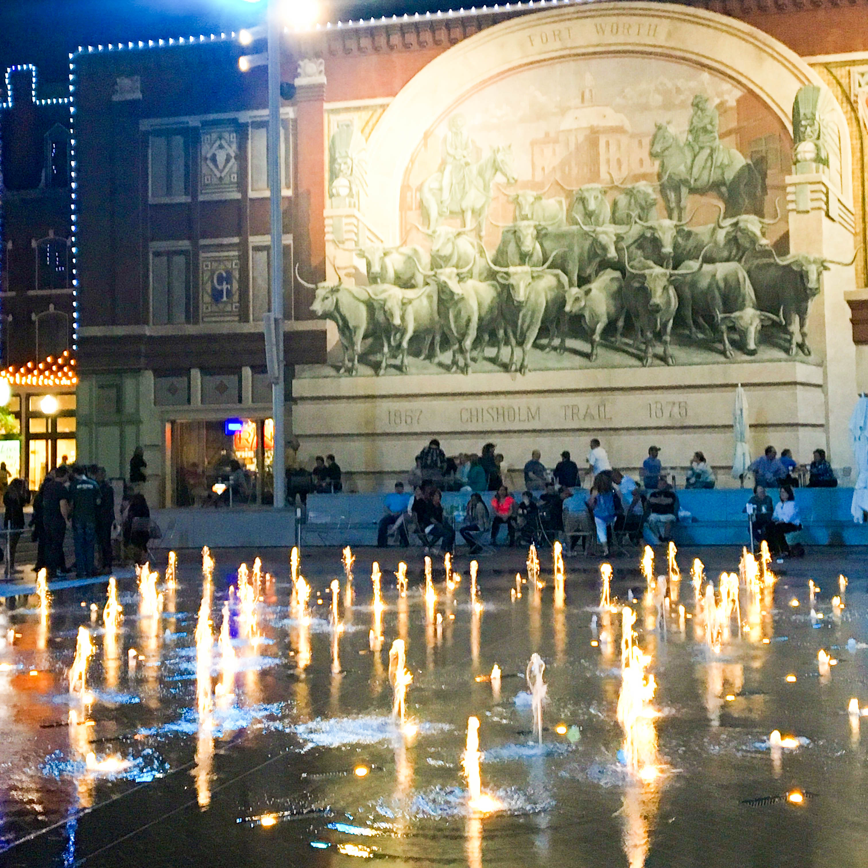 Fort Worth's Sundance Square at night when staying the weekend for the DFW Writers' Conference